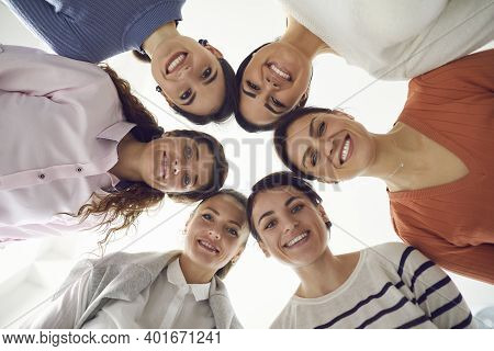 Group Of Happy Beautiful Women Standing Together In Circle And Smiling At Camera