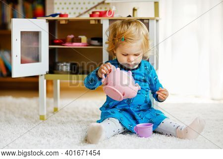 Adorable Cute Little Toddler Girl Playing With Toy Kitchen Happy Healthy Baby Child Having Fun With