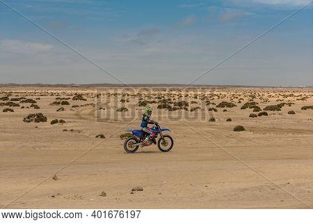 Namib Desert, Namibia-december 27, 2020: Motorcyclist On A Dirty Road In The Namib Desert, Namibia