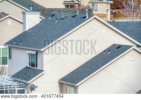 Aerial View Of House With Gray Gable Roofs And Plain White Exterior Wall