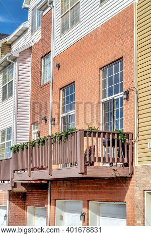 Exterior Of Townhouses With Balconies Accessed Through Cottage Pane Glass Doors