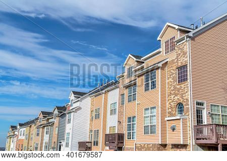 Clouds And Blue Sky On A Sunny Day Over Townhouses In The Valley Neighborhood