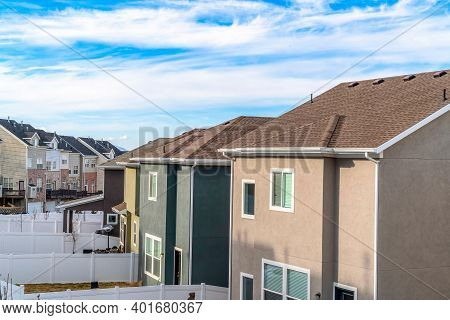 Two Storey Homes With Grassy Yards And Three Storey Townhouses With Balconies