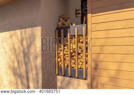 Stack Of Firewood In An Alcove Between Exterior Walls Of A Home In Park City