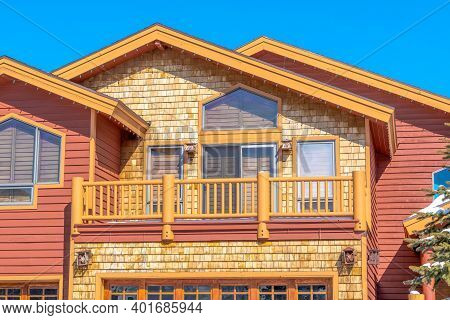 Exterior Of Home In Park City Utah With Sunlit Colorful Wall Against Blue Sky