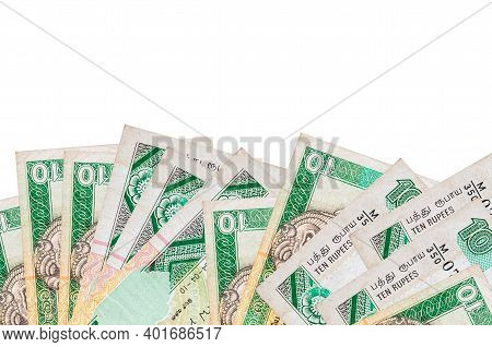 10 Sri Lankan Rupees Bills Lies On Bottom Side Of Screen Isolated On White Background With Copy Spac