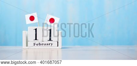 Wooden Calendar Of February 11th With Miniature Japan Flags. National Foundation Day,  New Year's Da