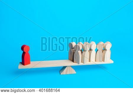 The Red Human Figurine Has Equal Weight Against A Group Of People. Leader And Valued Employee. Highl