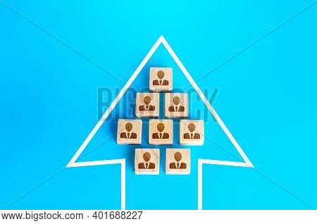 A Group Of People In The Arrow. Movement In A Single Formation. Joint Achievement Of Goals And Tasks