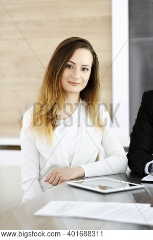 Business Woman Headshot At Workplace In Modern Office. Unknown Businesswoman Sitting Behind Computer