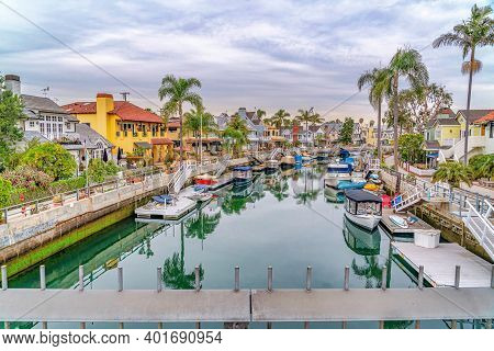 View Of The Scenic Canal With Boats From A Footbridge In Long Beach California