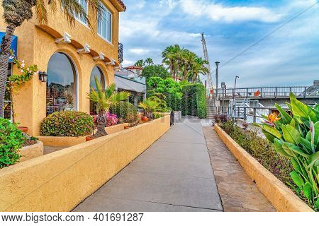 Walkway Along Home And Canal With Footbridge In Scenic Long Beach California