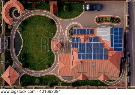 Aerial Top View Of New Modern Residential House Cottage With Blue Panels. Renewable Ecological Green
