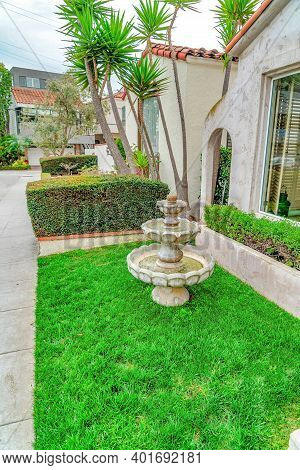 Three Tiered Fountain At The Landscaped Yard Of House In Long Beach California