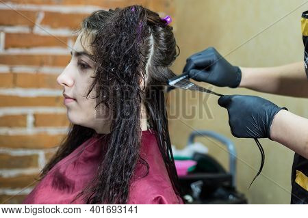 Brunette Girl Does Keratin Hair Straightening On Her Curly Hair. Keratin Hair Straightening In The S