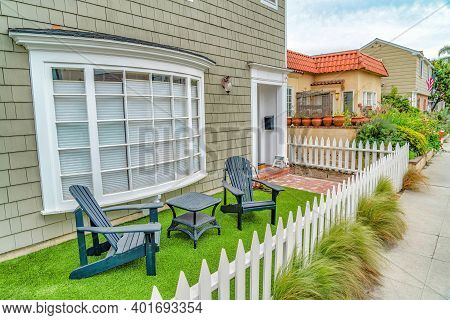 Front Yard Of House With Furniture Against Curved Bay Window In Long Beach Ca