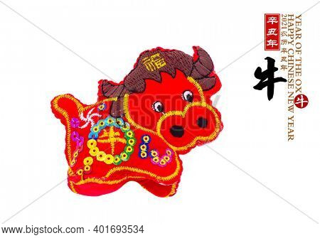 Tradition Chinese cloth doll ox,2021 is year of the ox,rightside Chinese characters and wording mean:Chinese calendar for the year.word on ox and red seal mean good bless