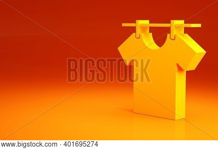 Yellow Drying Clothes Icon Isolated On Orange Background. Clean Shirt. Wash Clothes On A Rope With C