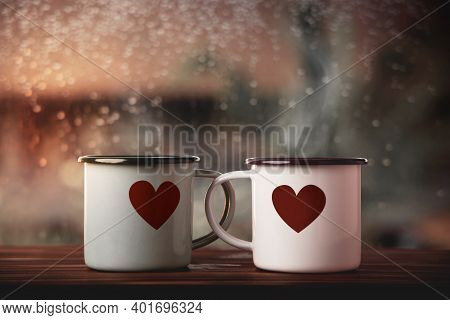 Love And Valentines Day Concept. Couple Of Coffee Cup With A Heart Shape By Glass Window In House. H