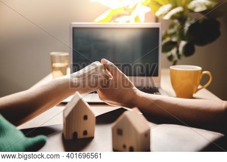 Buying A New House Concept. Couple Holding Hand And Seeing A Plan Design On Computer Laptop. Dream H