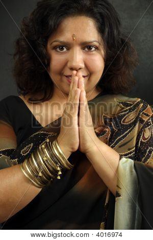 Smiling Indian Woman Praying