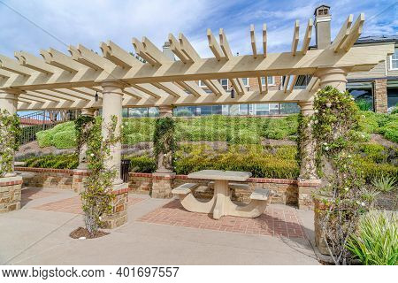 Sitting Area And Pergola With Vines In Huntington Beach California Neighborhood
