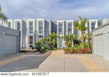 Modern Townhouse In Huntington Beach California Against Cloudy Sky On Sunny Day