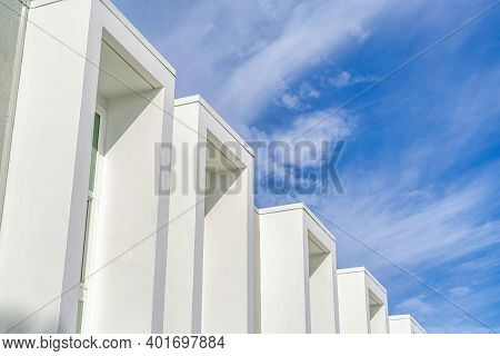 Exterior Of Modern Townhouse With Projecting Window Frames And Flat Roof Top