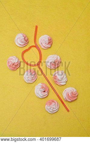 Pink And White Meringues Displayed With A Pink Heart Shape Straw