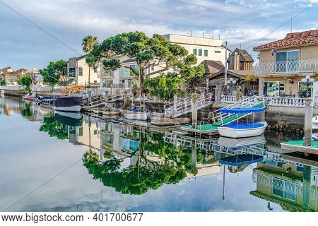 Water In Huntington Beach California Harbour With Reflection Of Trees And Sky