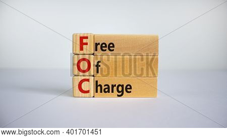 Foc - Free Of Charge Symbol. Concept Words 'foc - Free Of Charge' On Wooden Cubes And Blocks On A Be