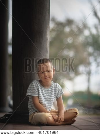 Outdoor portrait of a little cute boy