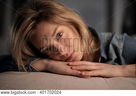 young woman relaxed on a sofa