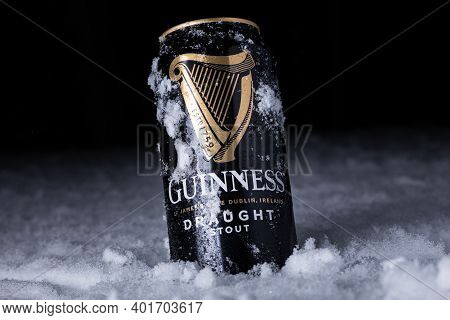 Can Of Guinness Draught Irish Beer In Snow, Winter. Minsk, Belarus - December 25, 2020