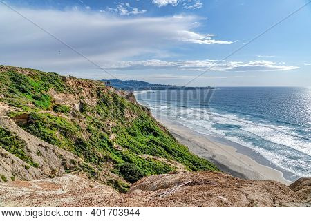Rocky Mountain Overlooking The Beach And Cloudy Blue Sky In San Diego California