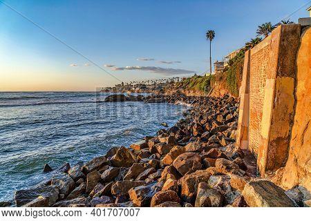 Ocean Waves Crashing On Rocky Shoreline At Teh Coast Of San Diego California