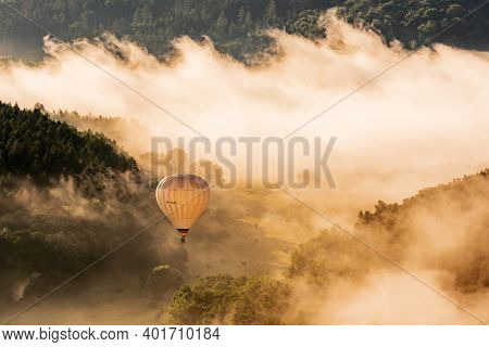 Hot Air Balloon Floating In The Morning Light