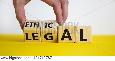 Ethical Or Legal Symbol. Businessman Hand Turns Wooden Cubes And Changes The Word 'legal' To 'ethica