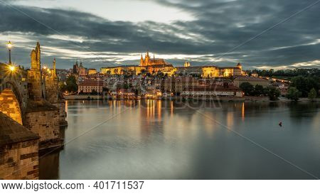 Charles Bridge Over The Vltava River In Prague With Castle In The Background.