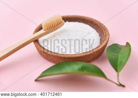 Wooden Bamboo Toothbrush And Baking Soda On A Pink Background. Eco Friendly Toothbrushes, Zero Waste