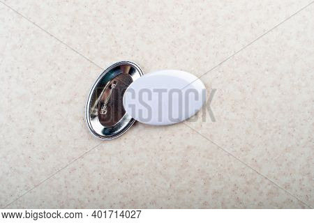 Empty Campaign Button Pins With Copy-space On Light Tabletop Flat Lay View. Space For Text