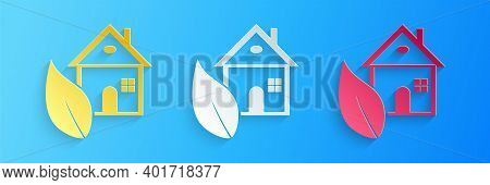 Paper Cut Eco Friendly House Icon Isolated On Blue Background. Eco House With Leaf. Paper Art Style.