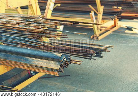 Stack Of Steel Pipe And Metal Beams On Rack. Metal Pipes, Profiles, Rods, Corners, Rails, A Choice O