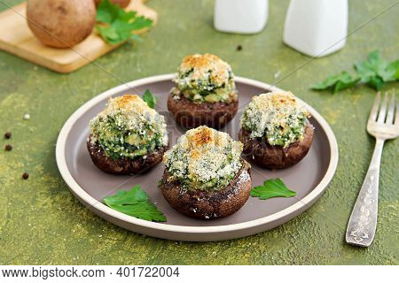 Baked Brown Mushrooms Stuffed With Spinach And Cheese, With Breadcrumbs And Cheese Crust On A Brown