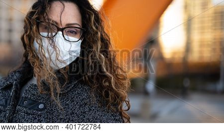 A Portrait Of A Woman Wearing A Mask In Downtown Milwaukee