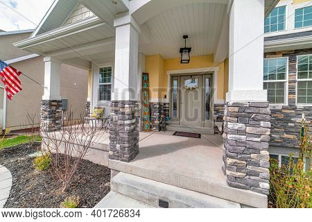 Home With Arched Entrance To The Open Porch And Front Door With Sidelights