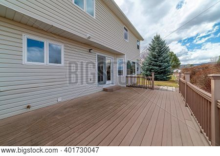 Two Storey House With Wooden Deck Overlooking The Yard And Scenic Nature Views