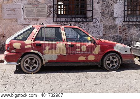 Santo Domingo,  Dominican Republic - January 11, 2017: Old Shabby Red Taxi Car Is Parked On A Street
