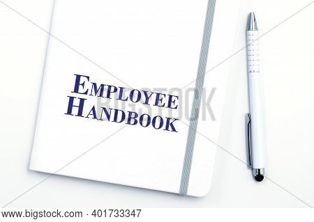 White Employee Handbook Or Manual With White Pen On White Table Surface - Personnel Management Polic