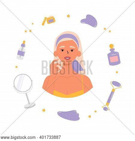 Young Beautiful Woman With Bottle Of Face Serum, Facial Gua Sha Stone, Roller, Mirror, Cream. Facial